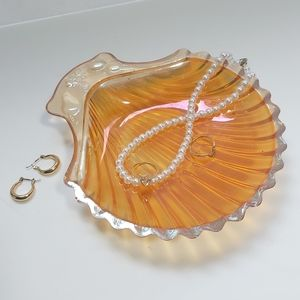 Orange vintage 1970s iridescent shell dish with fruit detailing